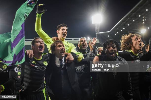 Cesar Azpilicueta manager Antonio Conte Thibaut Courtois Nathaniel Chalobah and David Luis of Chelsea celebrate winning the league after the Premier...