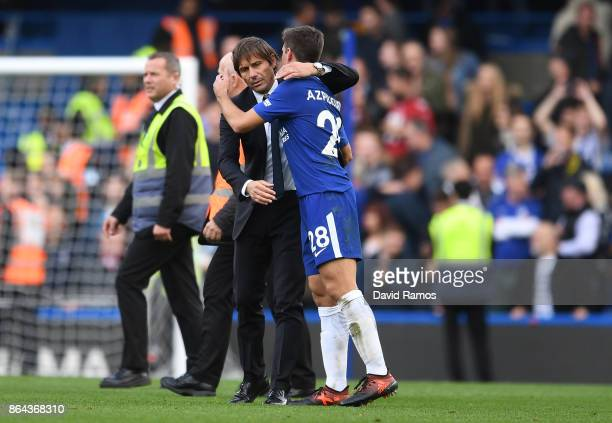Cesar Azpilicueta of Chelsea and Antonio Conte Manager of Chelsea react after the Premier League match between Chelsea and Watford at Stamford Bridge...