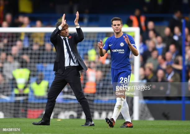 Cesar Azpilicueta of Chelsea and Antonio Conte Manager of Chelsea clap the fans after the Premier League match between Chelsea and Watford at...