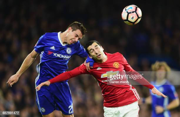 Cesar Azpilicueta of Chelsea and Henrikh Mkhitaryan of Manchester United jump for the ball during The Emirates FA Cup QuarterFinal match between...
