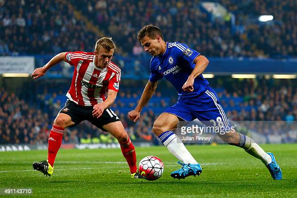 Cesar Azpilicueta of Chelsea and James WardProwse of Southampton compete for the ball during the Barclays Premier League match between Chelsea and...