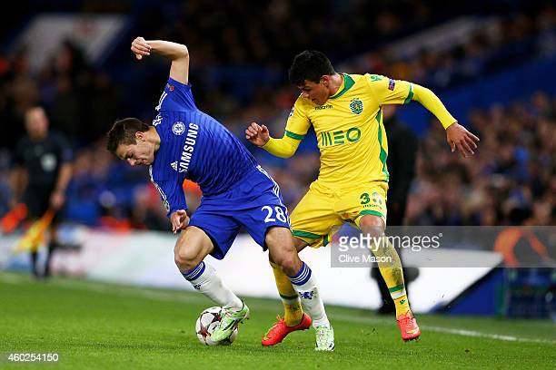 Cesar Azpilicueta of Chelsea and Jonathan Silva of Sporting Lisbon battle for the ball during the UEFA Champions League group G match between Chelsea...