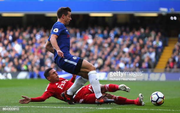 Cesar Azpilicueta of Chelsea and Jose Holebas of Watford in action during the Premier League match between Chelsea and Watford at Stamford Bridge on...