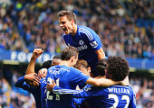 Cesar Azpilicueta of Chelsea and team mates mob Eden Hazard as he scores their first goal during the Barclays Premier League match between Chelsea...