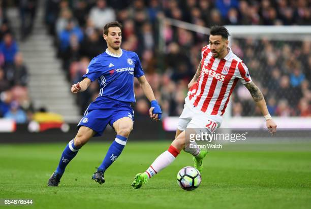 Cesar Azpilicueta of Chelsea beats Geoff Cameron of Stoke City during the Premier League match between Stoke City and Chelsea at Bet365 Stadium on...