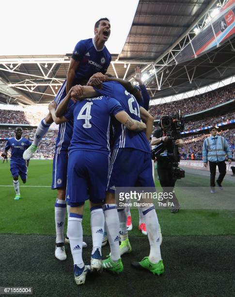 Cesar Azpilicueta of Chelsea celebrates his sides fourth goal scored by Nemanja Matic with team mates during The Emirates FA Cup SemiFinal between...
