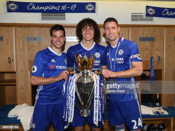 Cesar Azpilicueta of Chelsea David Luiz of Chelsea and Gary Cahill of Chelsea pose with the Premier League Trophy in the changing room after the...