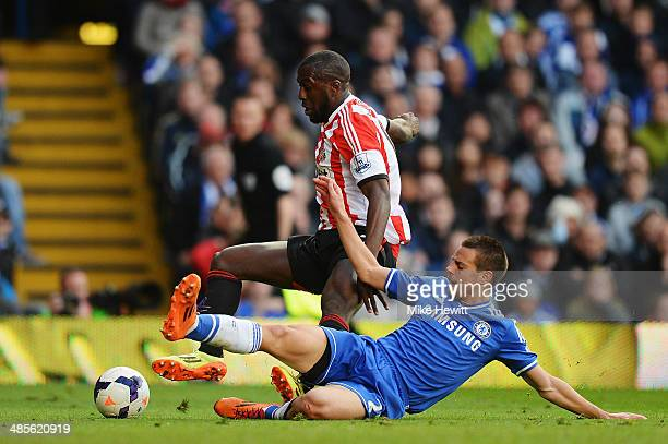 Cesar Azpilicueta of Chelsea fouls Jozy Altidore of Sunderland to concede a penalty during the Barclays Premier League match between Chelsea and...