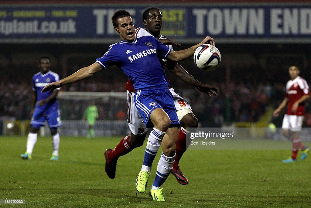 Cesar Azpilicueta of Chelsea holds off pressure from <a gi-track='captionPersonalityLinkClicked' href=/galleries/search?phrase=Nile+Ranger&family=editorial&specificpeople=5855942 ng-click='$event.stopPropagation()'>Nile Ranger</a> of Swindon during the Capital One Cup third round match between Swindon Town and Chelsea at County Ground on September 24, 2013 in Swindon, England.