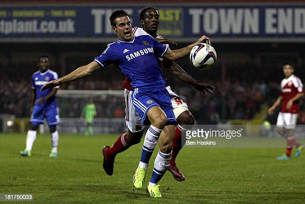 Cesar Azpilicueta of Chelsea holds off pressure from Nile Ranger of Swindon during the Capital One Cup third round match between Swindon Town and...