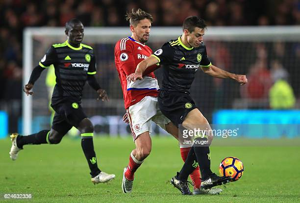 Cesar Azpilicueta of Chelsea is challenged by Gaston Ramirez of Middlesbrough during the Premier League match between Middlesbrough and Chelsea at...