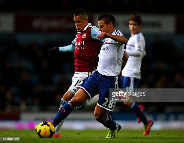 Cesar Azpilicueta of Chelsea is chased down by Ravel Morrison of West Ham during the Barclays Premier League match between West Ham United and...