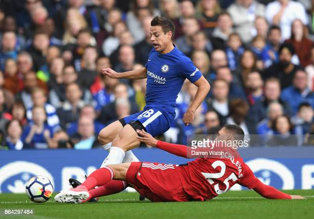 Cesar Azpilicueta of Chelsea is tackled by Jose Holebas of Watford during the Premier League match between Chelsea and Watford at Stamford Bridge on...