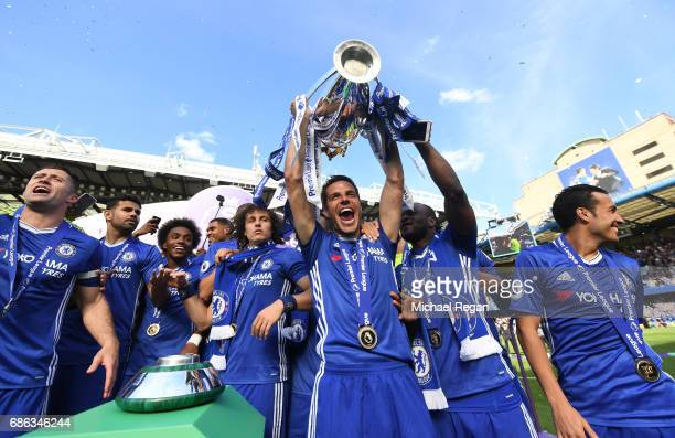 Cesar Azpilicueta of Chelsea lifts the Premier Leauge Trophy after the Premier League match between Chelsea and Sunderland at Stamford Bridge on May...
