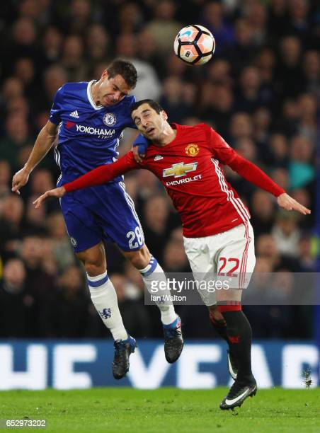 Cesar Azpilicueta of Chelsea outjumps Henrikh Mkhitaryan of Manchester United during The Emirates FA Cup QuarterFinal match between Chelsea and...