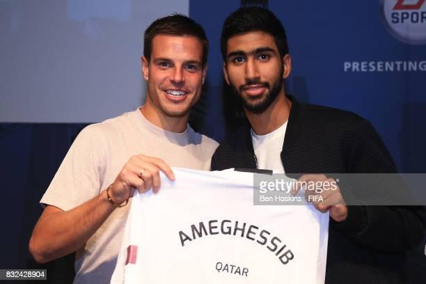 Cesar Azpilicueta of Chelsea presents Ahmed 'Ameghessib' AlMeghessib of Qatar with his shirt ahead of the FIFA Interactive World Cup 2017 on August...