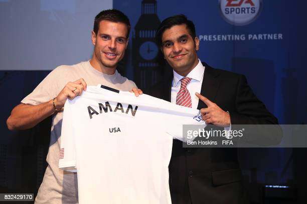 Cesar Azpilicueta of Chelsea presents Aman 'Aman' Seddiqi of The USA with his shirt ahead of the FIFA Interactive World Cup 2017 on August 15 2017 in...