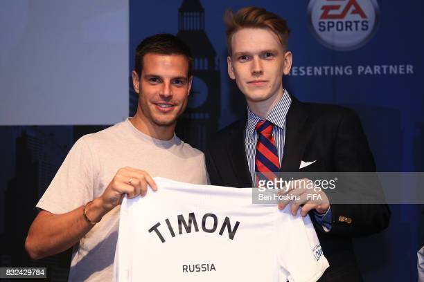 Cesar Azpilicueta of Chelsea presents Andrei 'Timon' Gurev of Russia with his shirt ahead of the FIFA Interactive World Cup 2017 on August 15 2017 in...