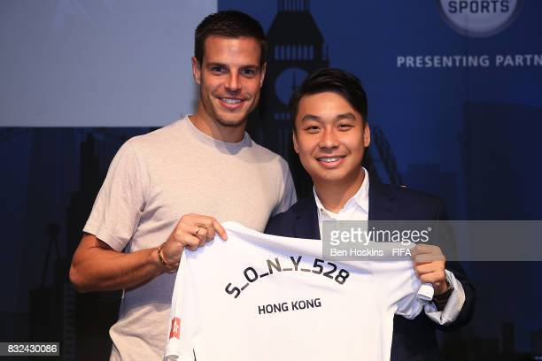 Cesar Azpilicueta of Chelsea presents Chi Hang 'S_O_N_Y_528' Chui of Hong Kong with his shirt ahead of the FIFA Interactive World Cup 2017 on August...