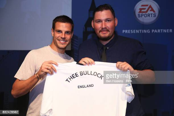 Cesar Azpilicueta of Chelsea presents Christopher 'Thee Bullock' Bullock of England with his shirt ahead of the FIFA Interactive World Cup 2017 on...