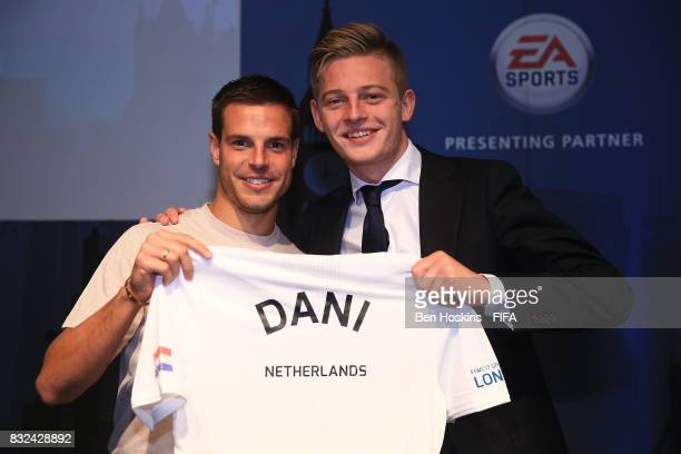 Cesar Azpilicueta of Chelsea presents Dani 'Dani' Hagebeuk of The Netherlands of England with his shirt ahead of the FIFA Interactive World Cup 2017...