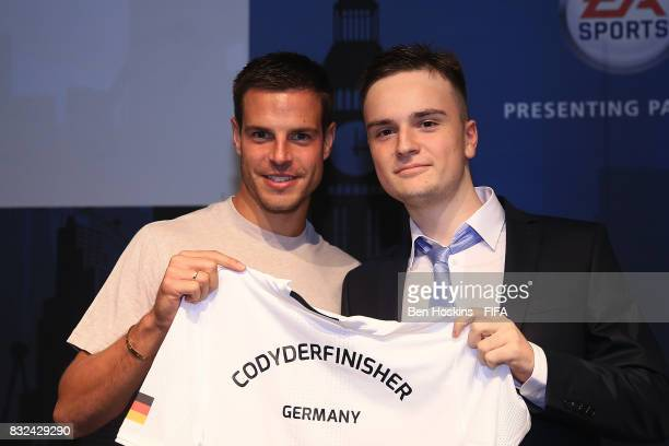 Cesar Azpilicueta of Chelsea presents Florian 'Codyderfinisher' Mller of Germany with his shirt ahead of the FIFA Interactive World Cup 2017 on...