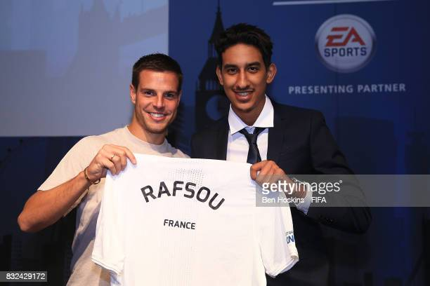 Cesar Azpilicueta of Chelsea presents Fouad 'Rafsou' Fares of France with his shirt ahead of the FIFA Interactive World Cup 2017 on August 15 2017 in...