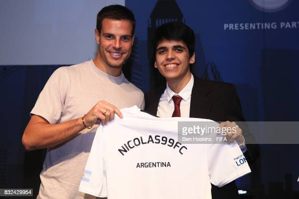 Cesar Azpilicueta of Chelsea presents Gonzalo 'Nicolas99FC' Villalba of Argentina with his shirt ahead of the FIFA Interactive World Cup 2017 on...