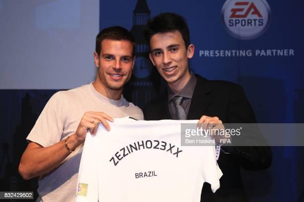 Cesar Azpilicueta of Chelsea presents Henrique 'Zezinho23XX' Lempke Silva of Brazil of Germany with his shirt ahead of the FIFA Interactive World Cup...