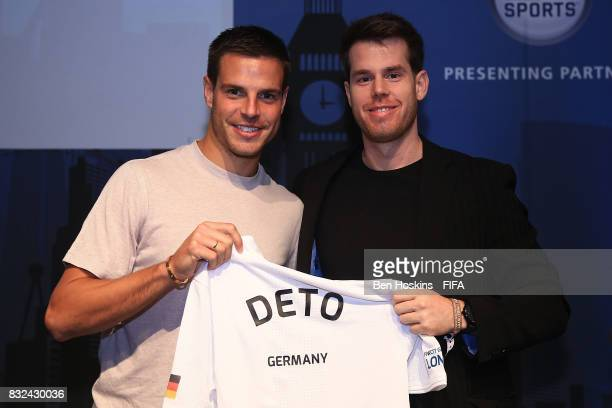 Cesar Azpilicueta of Chelsea presents Kai 'Deto' Wollin of Germany with his shirt ahead of the FIFA Interactive World Cup 2017 on August 15 2017 in...