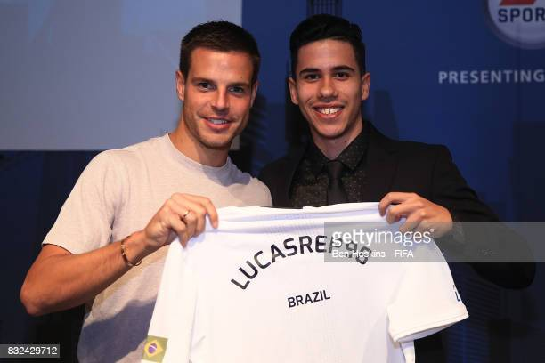 Cesar Azpilicueta of Chelsea presents Lucas 'Lucasrep_98' da Costa of Brazil with his shirt ahead of the FIFA Interactive World Cup 2017 on August 15...