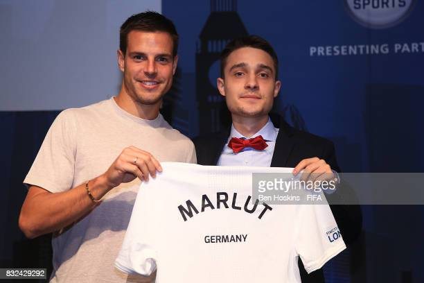 Cesar Azpilicueta of Chelsea presents Marcel 'Marlut' Lutz of Germany with his shirt ahead of the FIFA Interactive World Cup 2017 on August 15 2017...