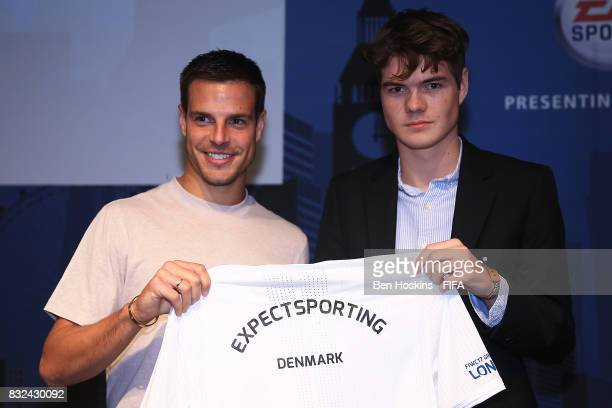 Cesar Azpilicueta of Chelsea presents Marcus 'ExpectSporting' Jorgensen of Denmark with his shirt ahead of the FIFA Interactive World Cup 2017 on...