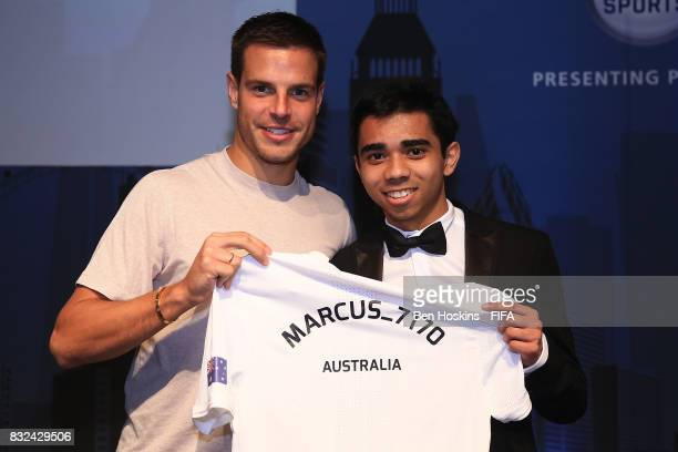 Cesar Azpilicueta of Chelsea presents Marcus 'Marcus_7170' Gomes of Australia with his shirt ahead of the FIFA Interactive World Cup 2017 on August...