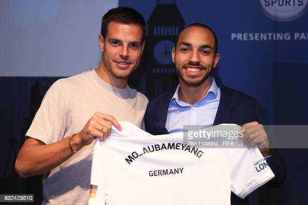 Cesar Azpilicueta of Chelsea presents Mohammed 'Mo_Aubameyang' Harkous of Germany with his shirt ahead of the FIFA Interactive World Cup 2017 on...