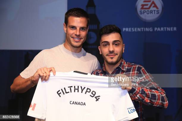 Cesar Azpilicueta of Chelsea presents Philip 'FilthyP94' Balkhe of Canada of England with his shirt ahead of the FIFA Interactive World Cup 2017 on...