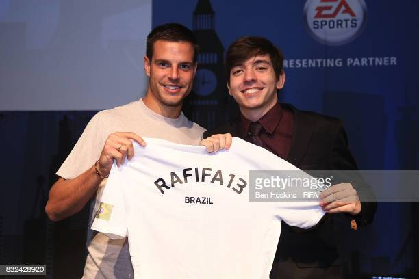 Cesar Azpilicueta of Chelsea presents Rafael 'Rafifa 13' Fortes of Brazil with his shirt ahead of the FIFA Interactive World Cup 2017 on August 15...