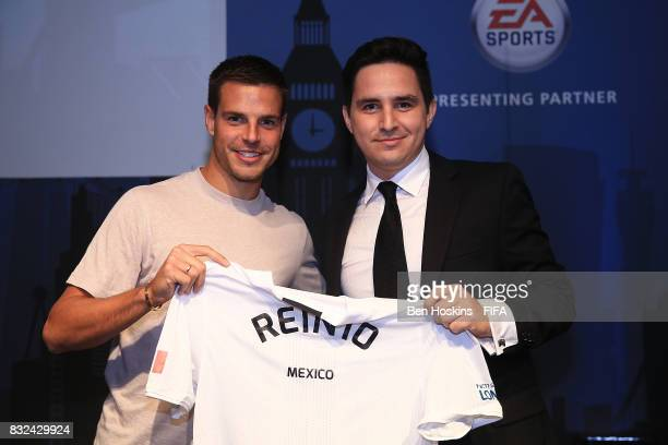 Cesar Azpilicueta of Chelsea presents Reinhard 'Rein10' Krause Manzotti of Mexico with his shirt ahead of the FIFA Interactive World Cup 2017 on...