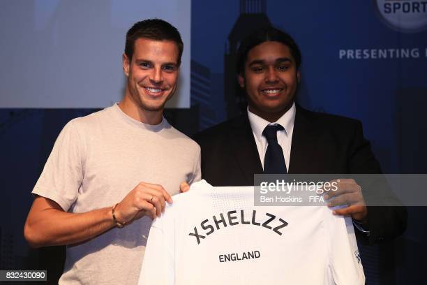 Cesar Azpilicueta of Chelsea presents Shaun 'Xshellzz' Springette of England with his shirt ahead of the FIFA Interactive World Cup 2017 on August 15...