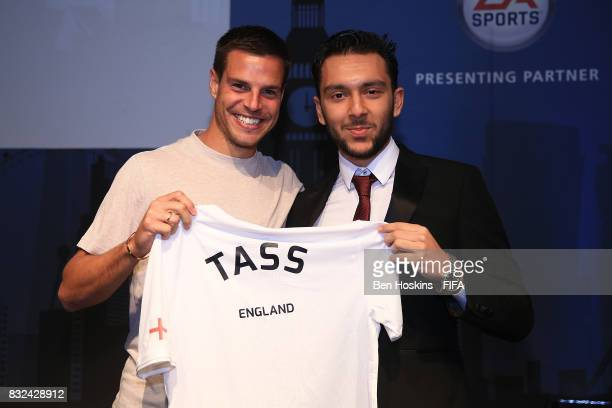 Cesar Azpilicueta of Chelsea presents Tassal 'Tass' Rushan of England with his shirt ahead of the FIFA Interactive World Cup 2017 on August 15 2017...