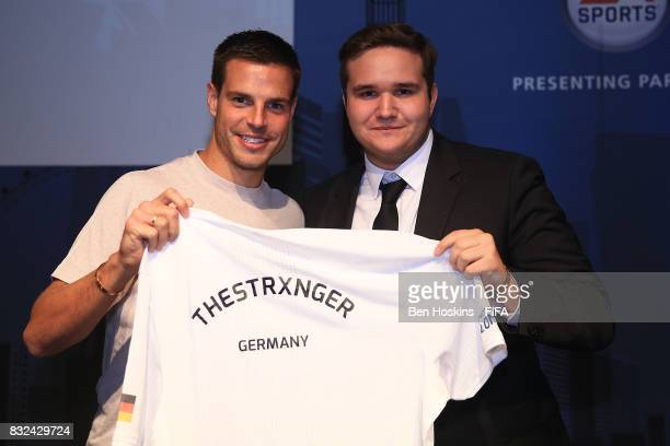Cesar Azpilicueta of Chelsea presents Tim 'TheStrxnger' Katnawatos of Germany with his shirt ahead of the FIFA Interactive World Cup 2017 on August...