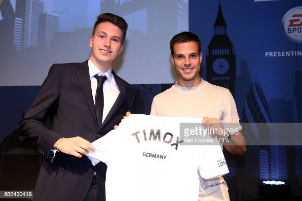 Cesar Azpilicueta of Chelsea presents Timo 'Timox' Siep of Germany with his shirt ahead of the FIFA Interactive World Cup 2017 on August 15 2017 in...