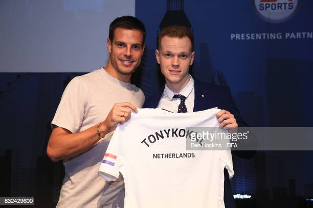 Cesar Azpilicueta of Chelsea presents Tony 'TonyKokNL' Kok of The Netherlands with his shirt ahead of the FIFA Interactive World Cup 2017 on August...