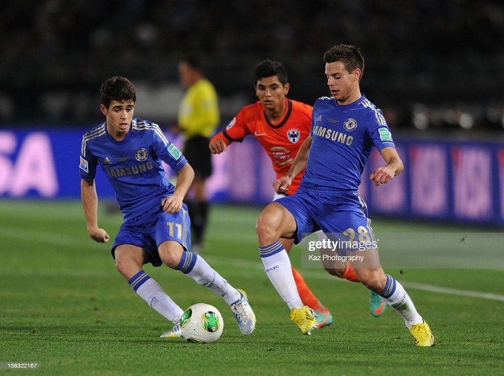 Cesar Azpilicueta (R) of Chelsea sends the pass while Oscar of Chelsea watches during the FIFA Club World Cup Semi Final match between CF Monterrey and Chelsea at International Stadium Yokohama on December 13, 2012 in Yokohama, Japan.
