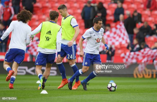 Cesar Azpilicueta of Chelsea warms up with team mates prior to the Premier League match between Stoke City and Chelsea at Bet365 Stadium on March 18...