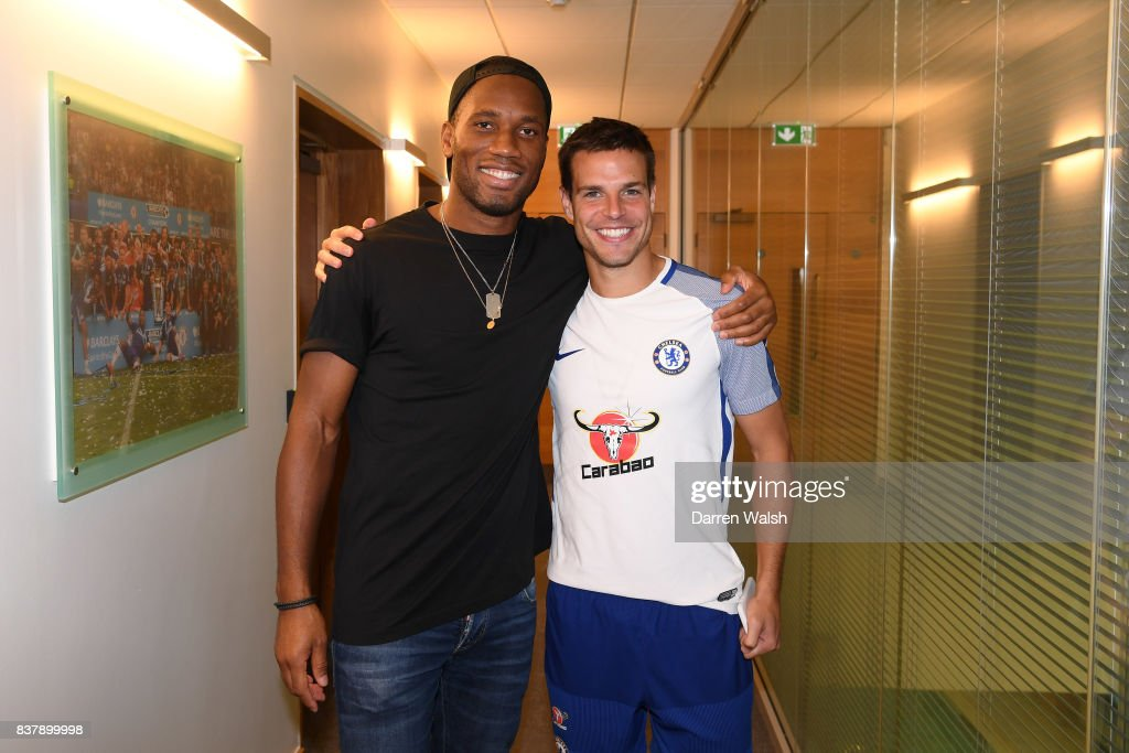 Cesar Azpilicueta of Chelsea with Ex Chelsea player Didier Drogba after a training session at Chelsea Training Ground on August 23, 2017 in Cobham, England.