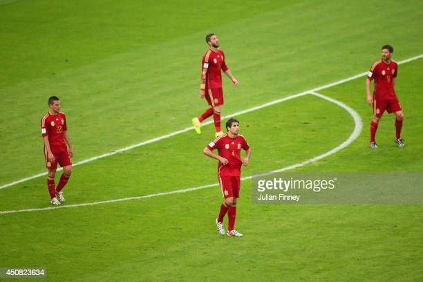 Cesar Azpilicueta Sergio Ramos Javi Martinez and Xabi Alonso of Spain react after giving up Chile's first goal during the 2014 FIFA World Cup Brazil...