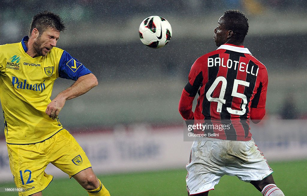 Cesar Bostian of Chievo and <a gi-track='captionPersonalityLinkClicked' href=/galleries/search?phrase=Mario+Balotelli&family=editorial&specificpeople=4940446 ng-click='$event.stopPropagation()'>Mario Balotelli</a> of Milan in acton during the Serie A match between AC Chievo Verona and AC Milan at Stadio Marc'Antonio Bentegodi on March 30, 2013 in Verona, Italy.