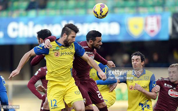Cesar Bostjan of AC Chievo competes for the ball with Fabio Quagliarella of Torino FCduring the Serie A match between AC Chievo Verona and Torino FC...