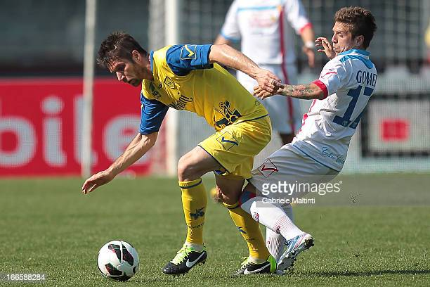 Cesar Bostjan of AC Chievo Verona fights for the ball with Alejandro Gomez of AC Calcio Catania during the Serie A match between AC Chievo Verona and...